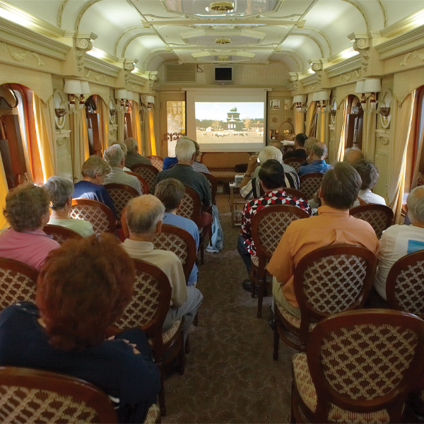 A lecture for tourists during a train journey